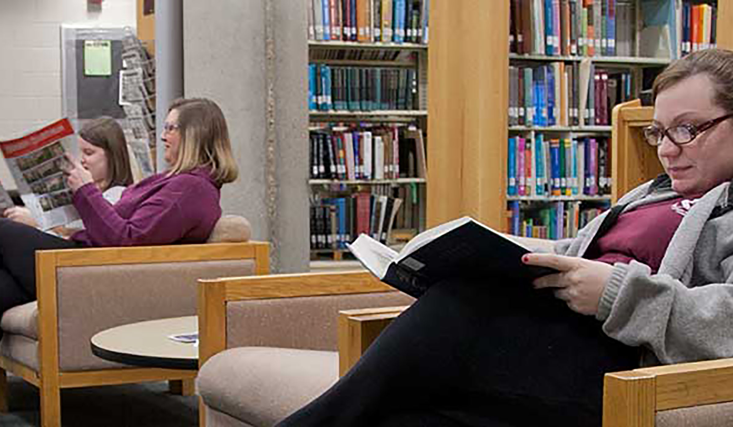 Several students in the reading room of the College of Veterinary Medicine Library.
