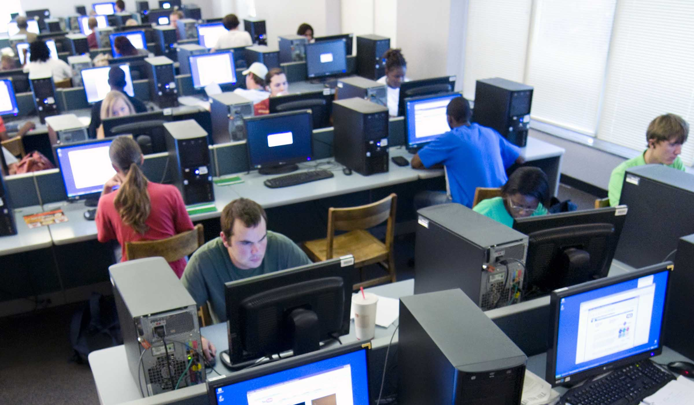 Students working at computer work stations.