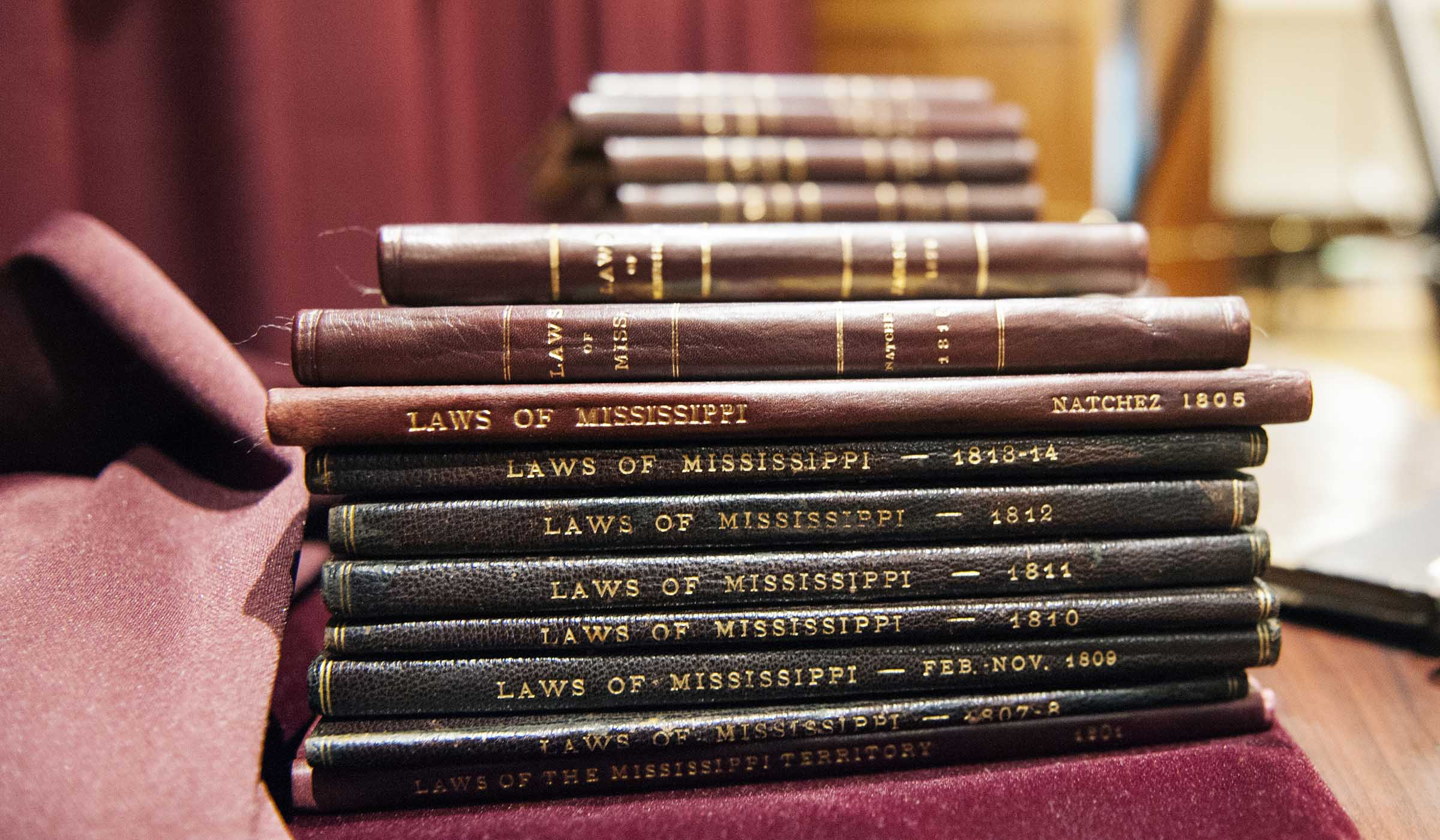 A stack of leather bound law books.