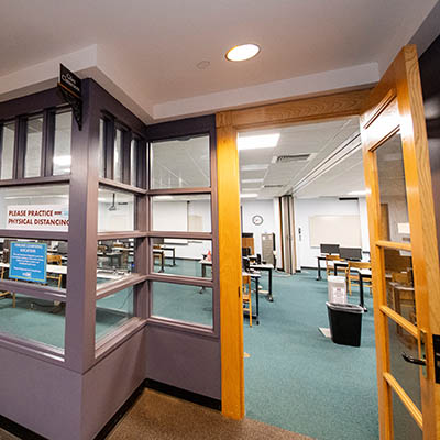 View of a classroom through an open door.